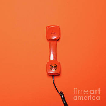 Retro orange telephone tube on orange background - Flat lay by Aleksandar Mijatovic