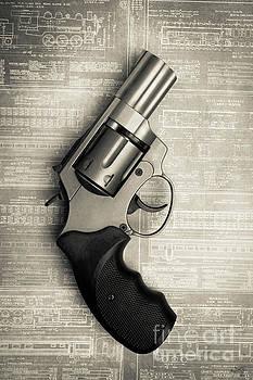 Revolver Pistol Gun over drawings by Edward Fielding