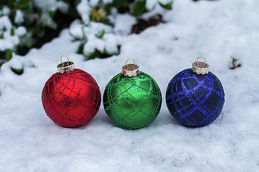 RGB Christmas balls on snowy ground by William Lee