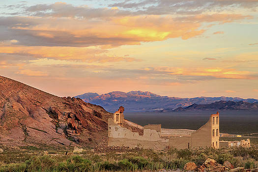 Rhyolite Bank At Sunset by James Eddy