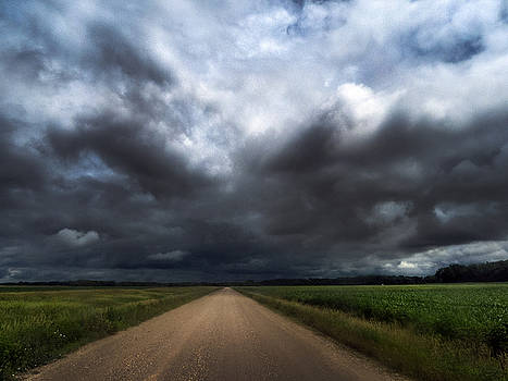 Riding into Dark Clouds by Eric Benjamin