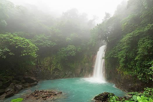 Rio celeste waterfall at foggy day by Juhani Viitanen