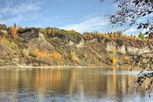 Riverbank in Autumn by Jim Sauchyn