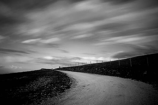 Road and clouds by Massimo Discepoli