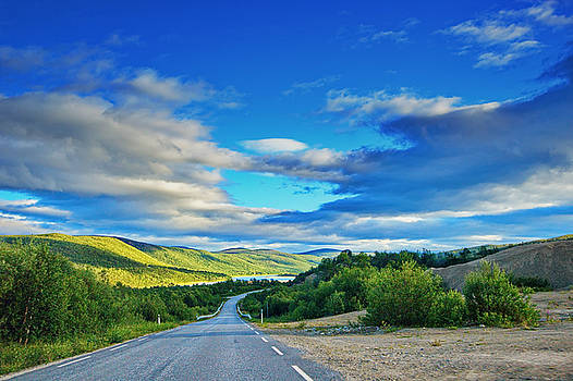 Road through Finnmark near river Tanaelven in arctic Norway by Intensivelight
