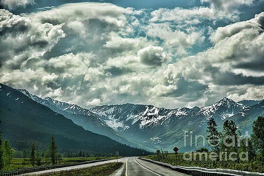 Road travel Alaska color  by Chuck Kuhn