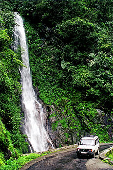 Roadside waterfall in the mountains of Arunachal Pradesh, India by Misentropy
