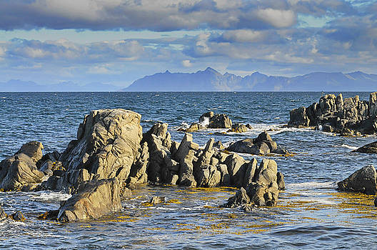 Rock formations in the sea on Lofoten by Intensivelight