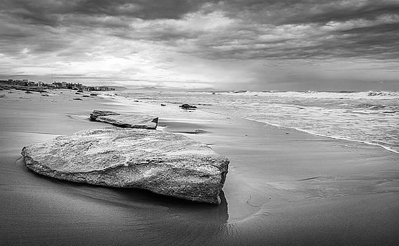 Rocks On A Sandy Beach. by Gary Gillette
