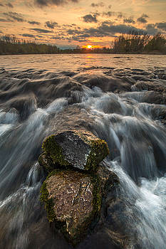 Rocks river and sunset by Davorin Mance