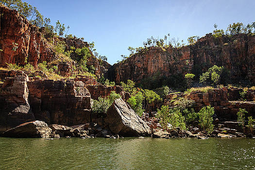 Rocky cliff face at Katherine River Gorge in Australia by Daniela Constantinescu