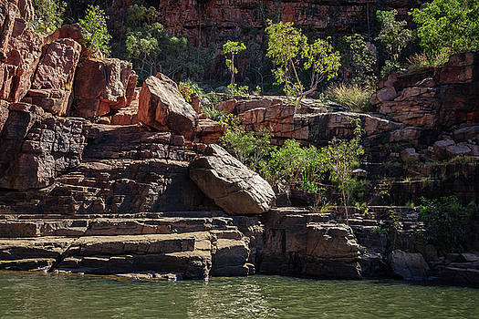 Rocky cliff face at Katherine River Gorge in Northern Territory by Daniela Constantinescu