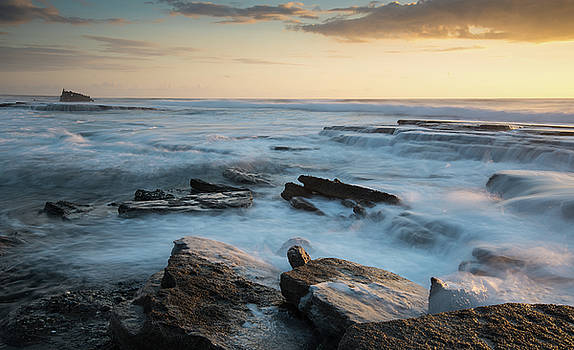 Rocky seashore during sunset by Michalakis Ppalis