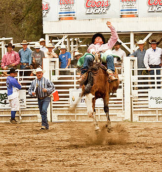 Rodeo Cowboy Riding a Bucking Bronco by Mark Hendrickson