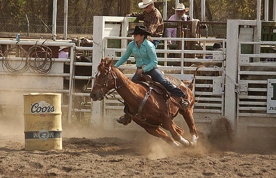 Rodeo Cowgirl Competes in Barrel Racing Event by Mark Hendrickson