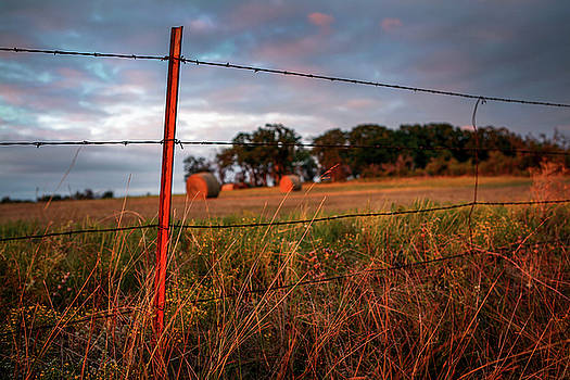 Round Bales and Barbed Wire at Sunset 002 by Lon Casler Bixby