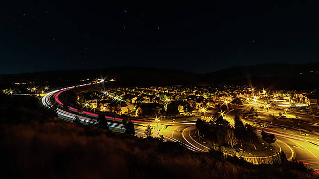 Roundabout Number Two, Village at Somersett, Reno, Nevada on a Summer Night with Light Trails by Brian Ball