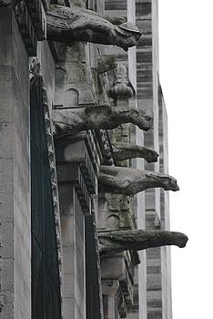 Row of gargoyles by Christopher Kirby