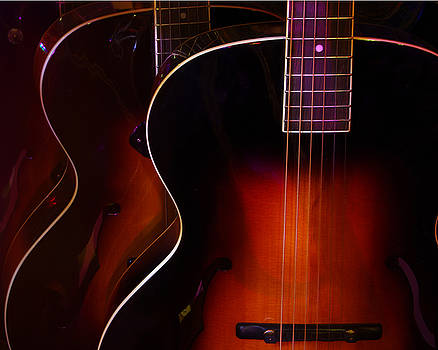 Row of guitars by Jim Mathis