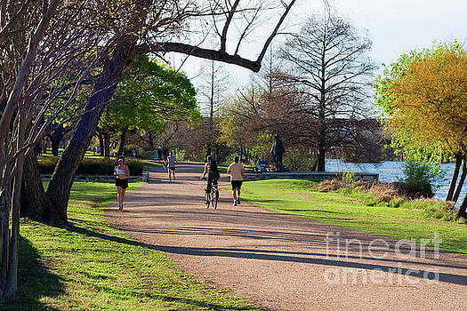 Herronstock Prints - Runners and bikers enjoy a perfect spring day on the Town Lake Hike and Bike Trail