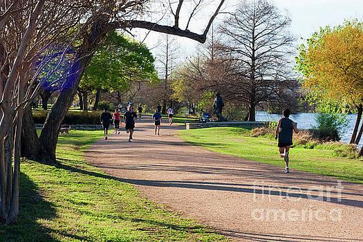 Herronstock Prints - Runners and joggers on the hike and bike trail town lake Austin Texas
