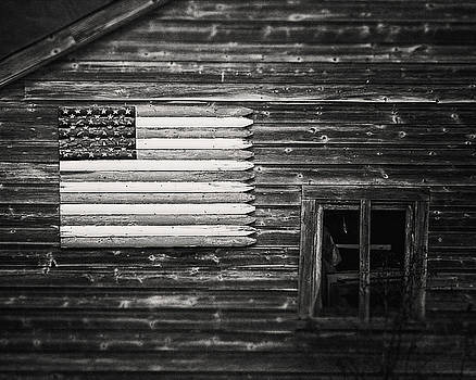 Rustic Black and White American Flag on a Weathered Barn by Lisa Russo