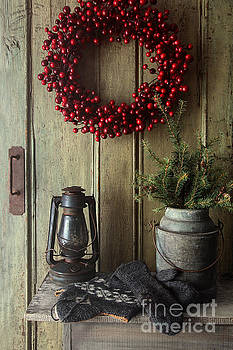 Sandra Cunningham - Rustic holiday scene with lamp on bench with wreath