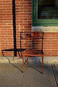 Corinne Rhode - Rusty chair at sunset