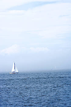 Sailboat On Water With Misty Sky by Gillham Studios