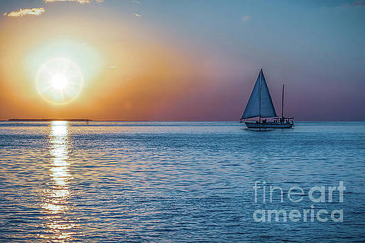 Sailing into the sunset by C W Hooper