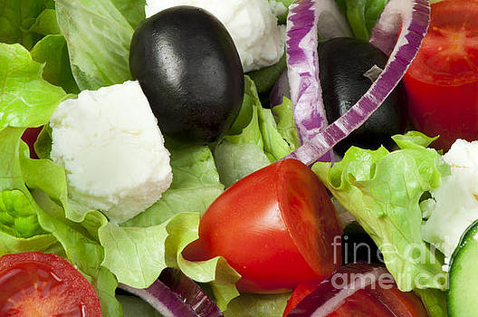 Salad in a glass bowl close up.  by Deyan Georgiev