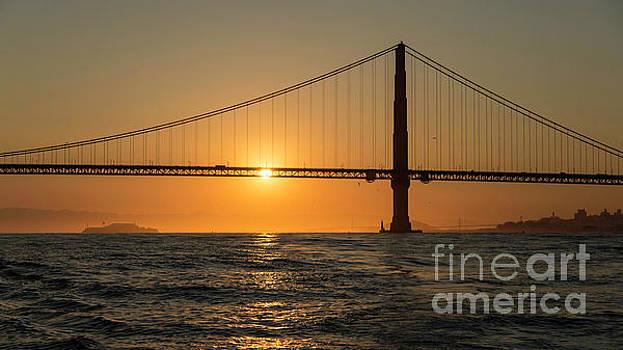 Salmon Sunrise Under the Golden Gate by Hugh Stickney