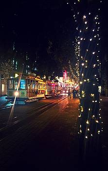 San Francisco Trolleys During Christmas by Nicole Alvarez