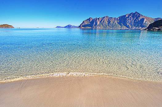 Sandy beach and crystal clear water by Intensivelight