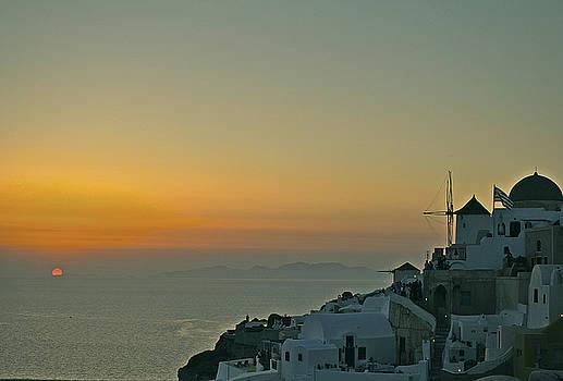 Santorini on green sunset by Renato Armignacco