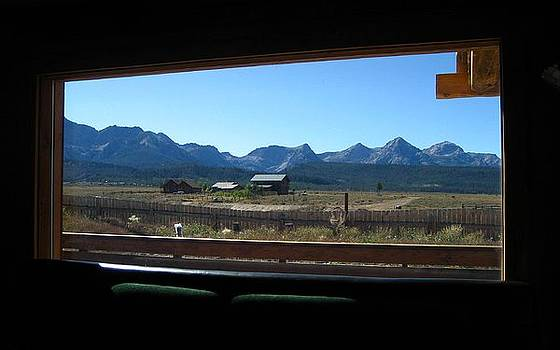 Sawtooth Mountains from cafe window by Sherry Oliver