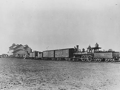 Chicago and North Western Historical Society - Steam Engine Makes Stop at Depot