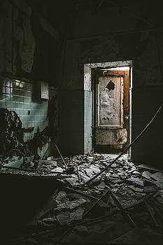 Scary Room and Open Door in Abandoned Building by Dylan Murphy