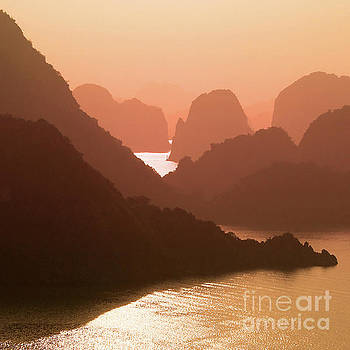 Scenic sunset in Halong Bay, Vietnam by Delphimages Photo Creations