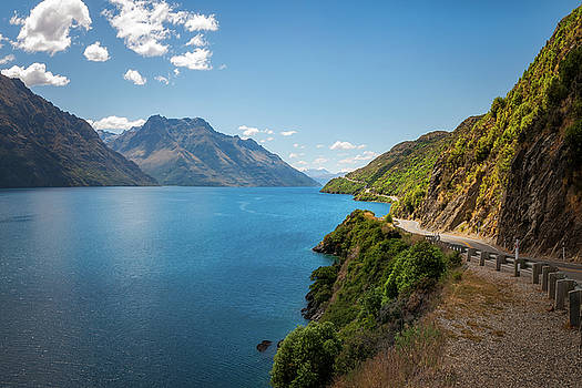 Scenic winding road at Lake Wakatipu, New Zealand by Daniela Constantinescu