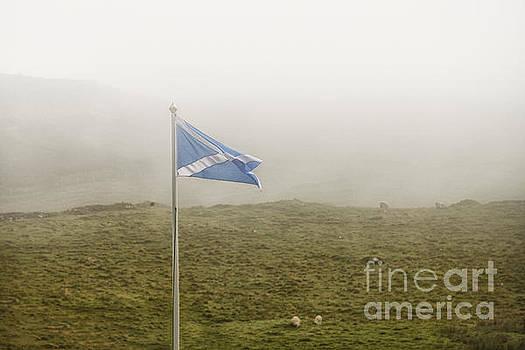 Patricia Hofmeester - Scottish flag in the fog