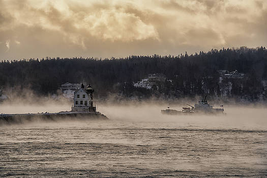 Sea Smoke at Rockland Breakwater Light by Jesse MacDonald