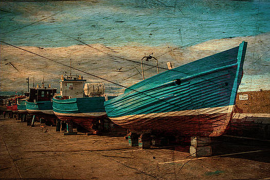 Seahouses Boats hauled out for Winter. by Paul Cullen