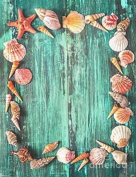 Seashell and starfish frame on wooden background by Jelena Jovanovic