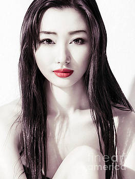 Sensual beauty portrait of young asian woman face with red lips by Oleksiy Maksymenko