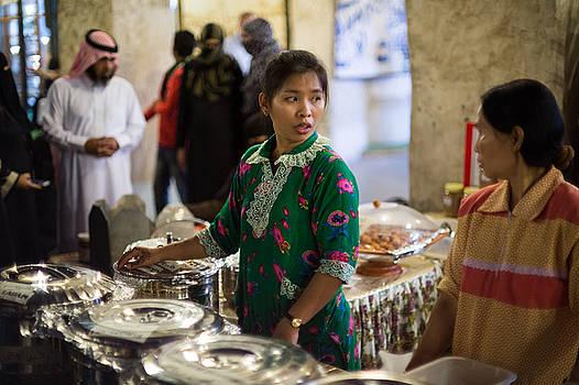 Serving food in Doha Souq by Paul Cowan