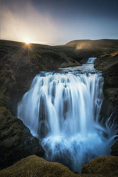 Setting Sun Above Iceland Waterfall by James Udall