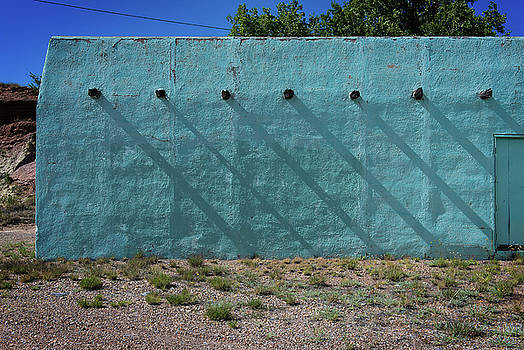 Shadows on turquoise wall by Bud Simpson