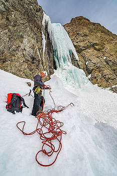 Shane Nelson preparing to climb  Preacher rated WI5 near Sun Val by Elijah Weber