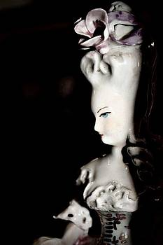 She has skin like porcelain... by Jill Tennison